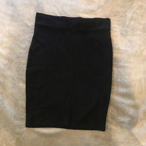 Tight knit black knee length skirt